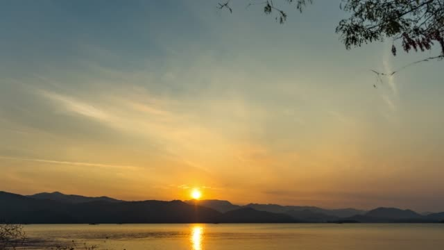 beautiful sunrise over mountains and lake, time lapse video - mountain stock videos & royalty-free footage