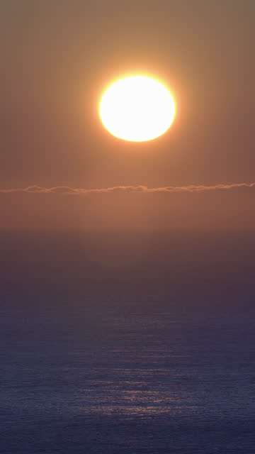 beautiful sunrise over pacific ocean, splash of waves in sea. vertical format video - pacific coast stock videos & royalty-free footage