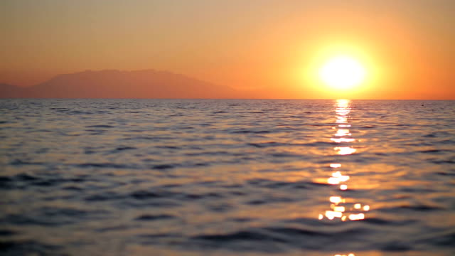 beautiful sunrise over the sea - greek islands stock videos and b-roll footage