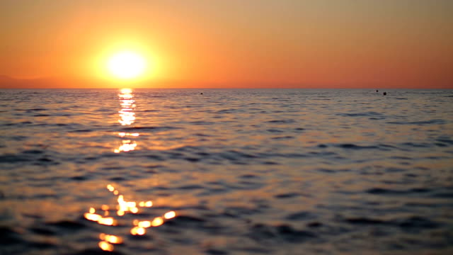 beautiful sunrise over the sea - orizzonte sull'acqua video stock e b–roll
