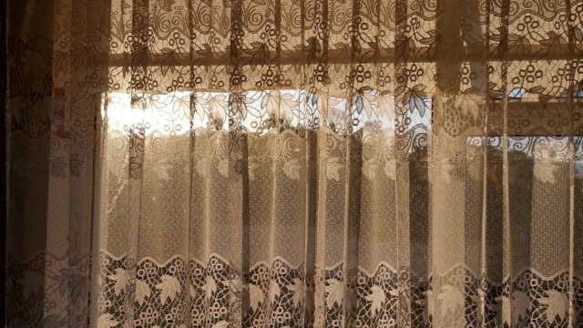 vídeos y material grabado en eventos de stock de beautiful sunrise through the window with curtain - imagen virada