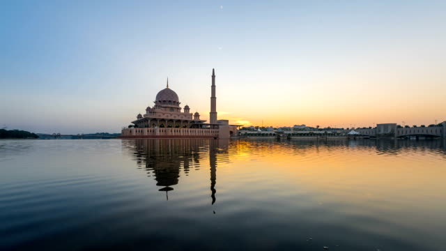 beautiful sunrise timelapse at a mosque. pan down motion - putrajaya stock videos & royalty-free footage