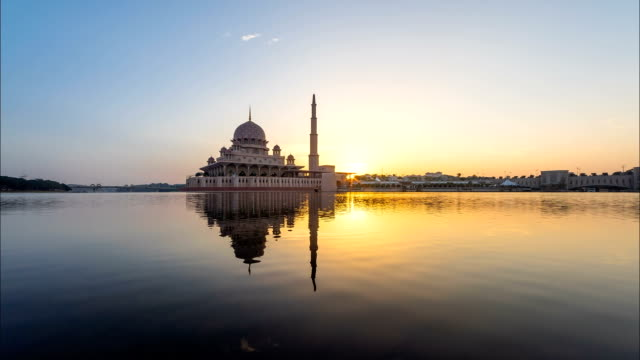 beautiful sunrise timelapse at a mosque with reflection - putrajaya stock videos & royalty-free footage