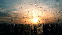 Beautiful sunrise while raining. Watching the sunrise behind the window. 4K