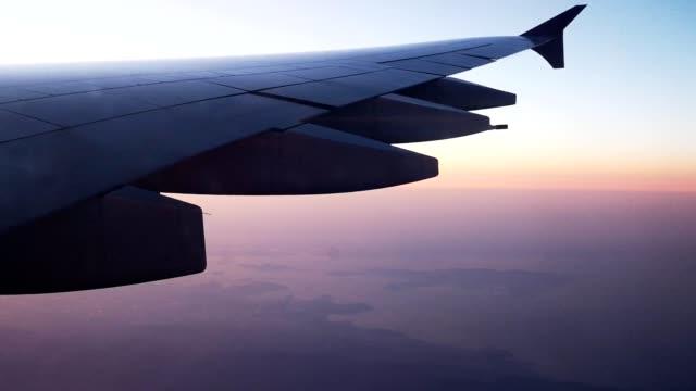 beautiful sunset aerial photo from airplane in japan - 里山点の映像素材/bロール