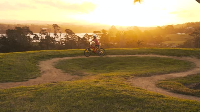 beautiful sunset and a bike rider. - auckland stock videos & royalty-free footage
