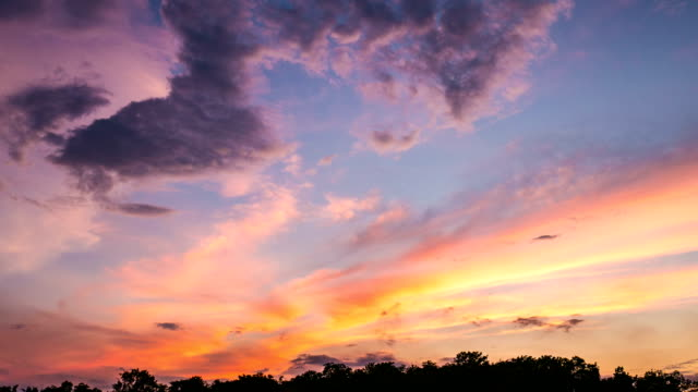 Beautiful Sunset and Moving Clouds at Dusk, Dramatic sky. Time-lapse video