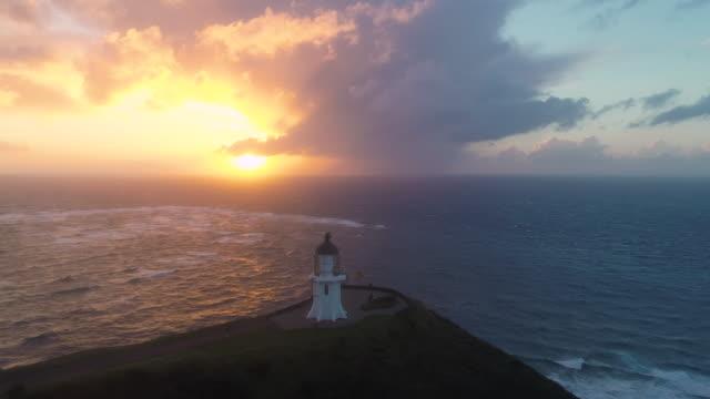 beautiful sunset at cape reinga, lighthouse. - new zealand stock videos & royalty-free footage