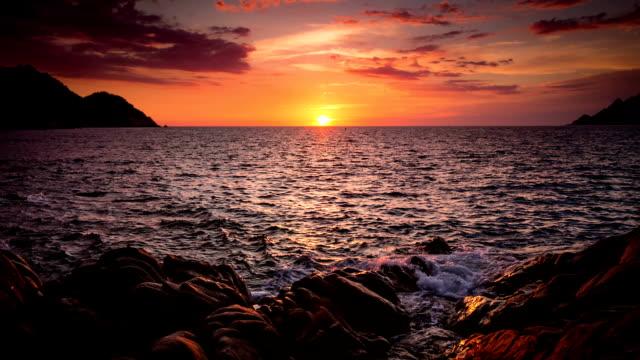 beautiful sunset at sea - rocky coastline stock videos & royalty-free footage