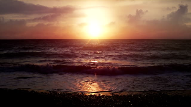 beautiful sunset at the beach in superslowmotion - surrealism stock videos and b-roll footage