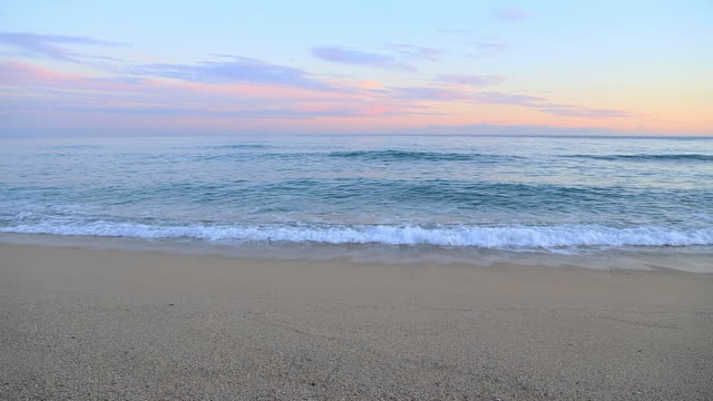 vidéos et rushes de beautiful sunset footage on the beach with colorful sky. - rivage