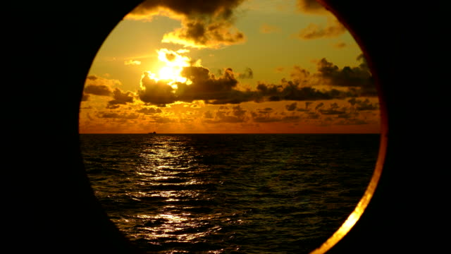 beautiful sunset in the atlantic ocean through the porthole of a ship - porthole stock videos & royalty-free footage