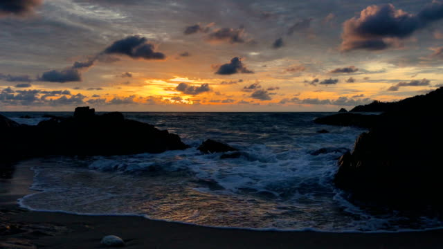 Beautiful sunset on the beach of Kalim Phuket Thailand, 4K.