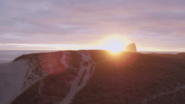 beautiful sunset on the oregon coast - haystack rock stock videos & royalty-free footage
