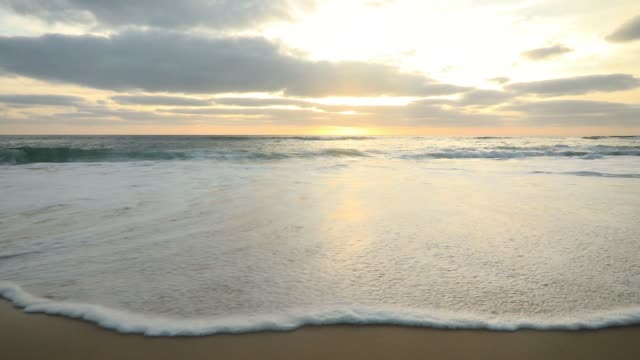 beautiful sunset on the shores of the atlantic ocean. sandy beach and waves - normandy stock videos & royalty-free footage