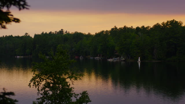 beautiful sunset over a pristine lake - fatcamera stock videos & royalty-free footage