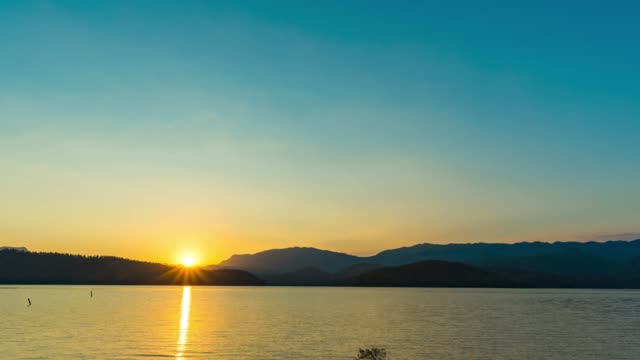 beautiful sunset over mountains and lake, day to sunset time lapse - day to sunset stock videos & royalty-free footage