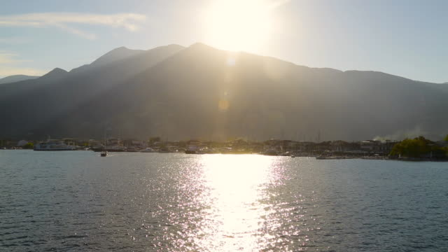 beautiful sunset over mountains during boat ride - hill stock videos & royalty-free footage