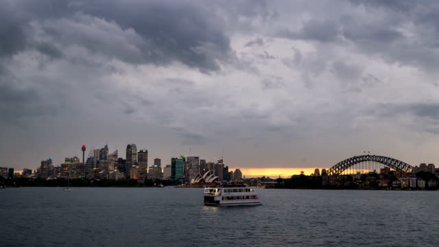 beautiful sunset over sydney harbour take from cremorne point point revealing the bridge and opera house. - weather stock videos & royalty-free footage