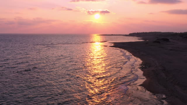 beautiful sunset over the sea - water's edge stock videos & royalty-free footage