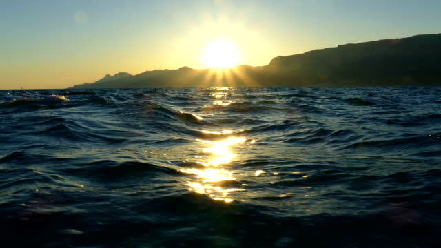 beautiful sunset over the waves - yachting stock videos & royalty-free footage