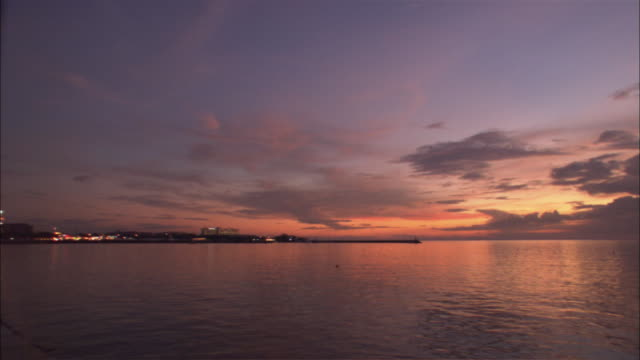 a beautiful sunset reflects in manila bay. - seascape stock videos & royalty-free footage