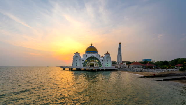 beautiful sunset view of the malacca strait mosque. timelapse - malacca stock videos and b-roll footage