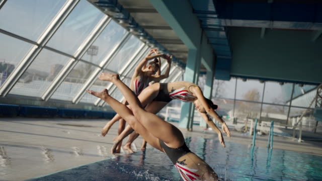 beautiful synchronized swimming performance - swimming costume stock videos & royalty-free footage