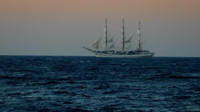 beautiful tall ship in full sail at sunset - veliero video stock e b–roll