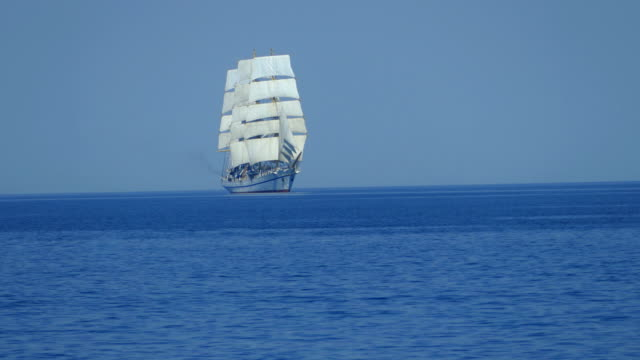 beautiful tall ship  on all sails in the open sea - nave a vela video stock e b–roll