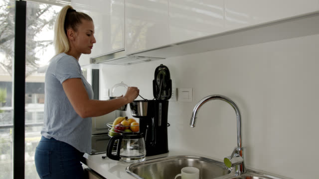 beautiful tall woman preparing coffee at home - flat stock videos & royalty-free footage