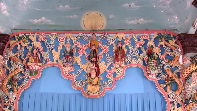a beautiful tapestry hangs from the ceiling of the cao dai temple. - tay ninh stock videos & royalty-free footage
