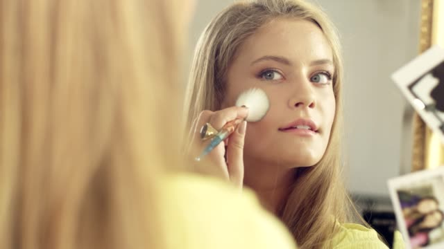 beautiful teen girl putting on first make up - preparation stock videos & royalty-free footage