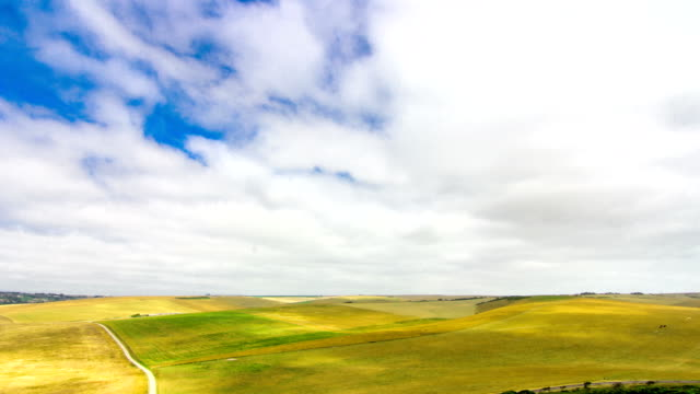 Beautiful Timelapse with amazing clouds moving over vast farm fields on a windy summer day