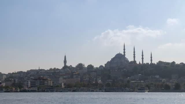 beautiful tl view of touristic landmarks at eminonu district in afternoon among air pollution - ottoman stock videos & royalty-free footage