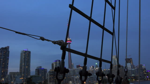 beautiful toronto skyline and cn tower at dusk from a sail cruise ship cruises on lake ontario are a very popular tourist attraction in the canadian... - lake ontario bildbanksvideor och videomaterial från bakom kulisserna