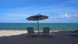 Beautiful tropical beach and sea with umbrella and chair lounge for holiday and travel