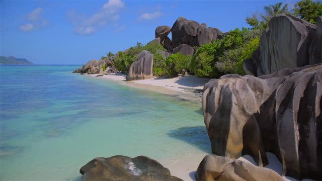 beautiful tropical beach anse source d´argent with sculpted granite rocks and palm trees - island of la digue, seychelles, indian ocean islands. - exoticism stock videos & royalty-free footage