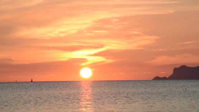 beautiful tropical beach omega sunset in thailand - omega sun mirage stock videos & royalty-free footage