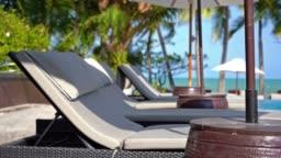 Beautiful umbrella and chair around swimming pool nearly sea beach