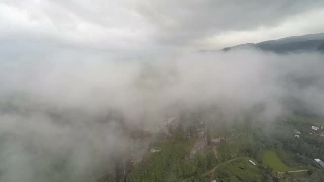 beautiful valley and huge solid rock covered by mist, aerial - granite rock stock videos & royalty-free footage