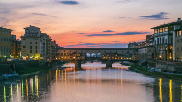 Beautiful view at buildings and colors are reflected, The River Arno in Florence, Italy.