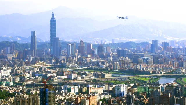 beautiful view of an airplane flying over taipei city at sunset - taipei stock videos & royalty-free footage