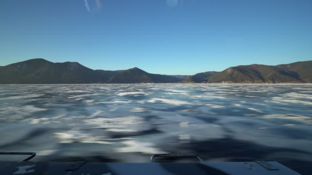 beautiful view of frozen lake baikal seen from hovercraft against clear blue sky - frozen water stock videos & royalty-free footage