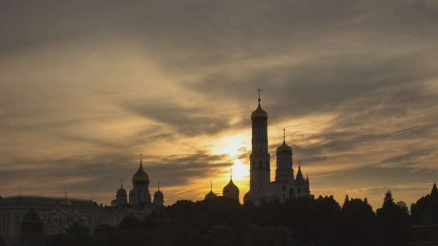 beautiful view of the dome of the moscow kremlin churches with clouds at sunset - international landmark stock videos & royalty-free footage
