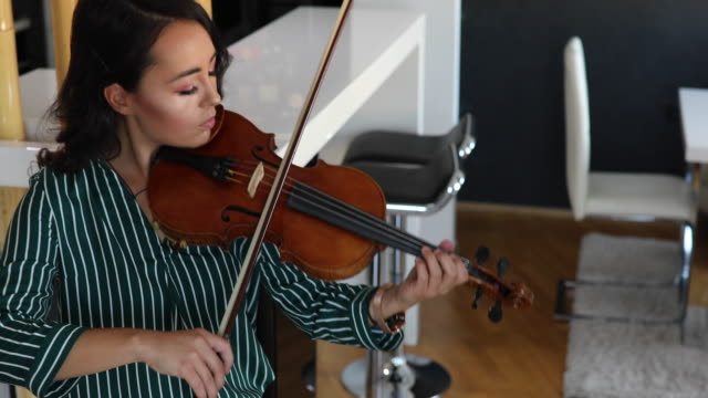 beautiful violinist at home - artist stock videos & royalty-free footage