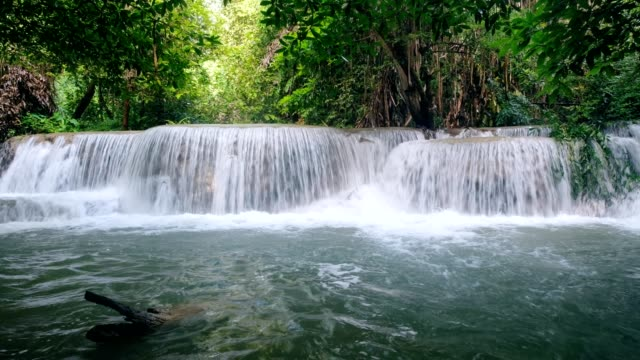 beautiful waterfall flowing rapids in tropical rainforest - laos stock videos and b-roll footage