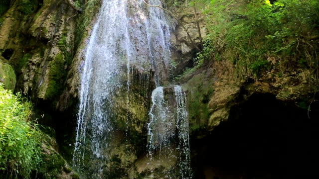 Beautiful waterfall in forest, reverse motion