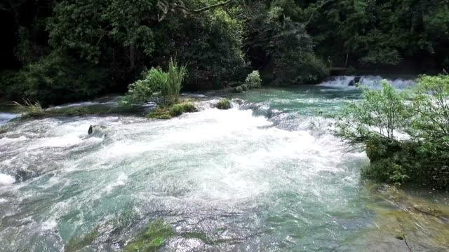 beautiful waterfall in guizhou province - flowing water stock videos & royalty-free footage