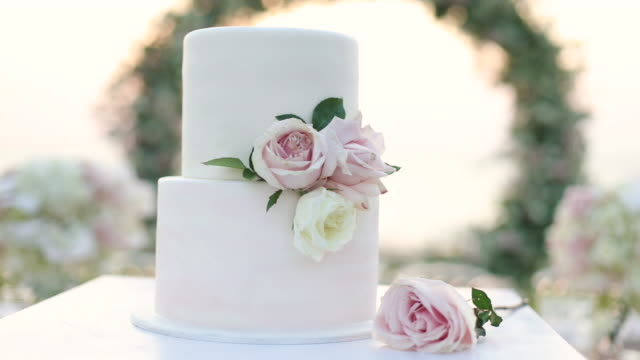 beautiful wedding cake decorated with flowers and white tone. - wedding reception stock videos & royalty-free footage